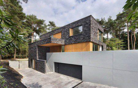 Современный лесной дом с камня от Zecc Architecten