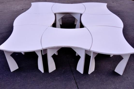 Белый стол, способный раскладываться на части