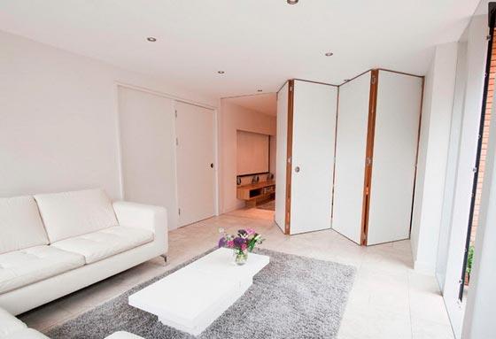 Зонирование комнаты с помощью стены-гармошки