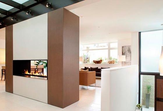 Зонирование квартиры и дома с помощью камина
